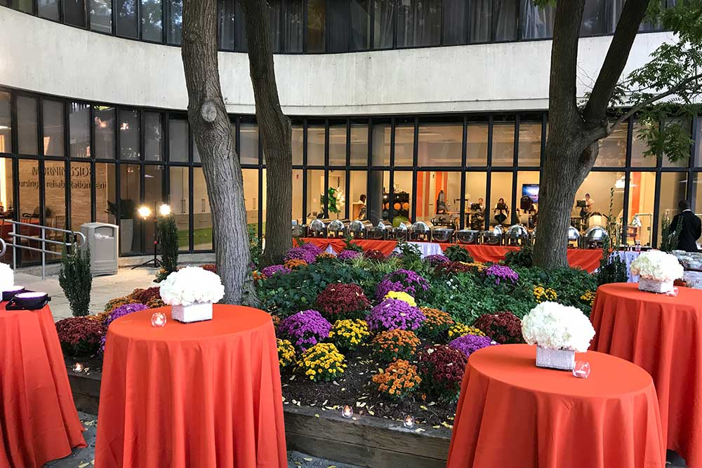 Courtyard at Morningside arranged beautifully with tables, flowers, and decorations.